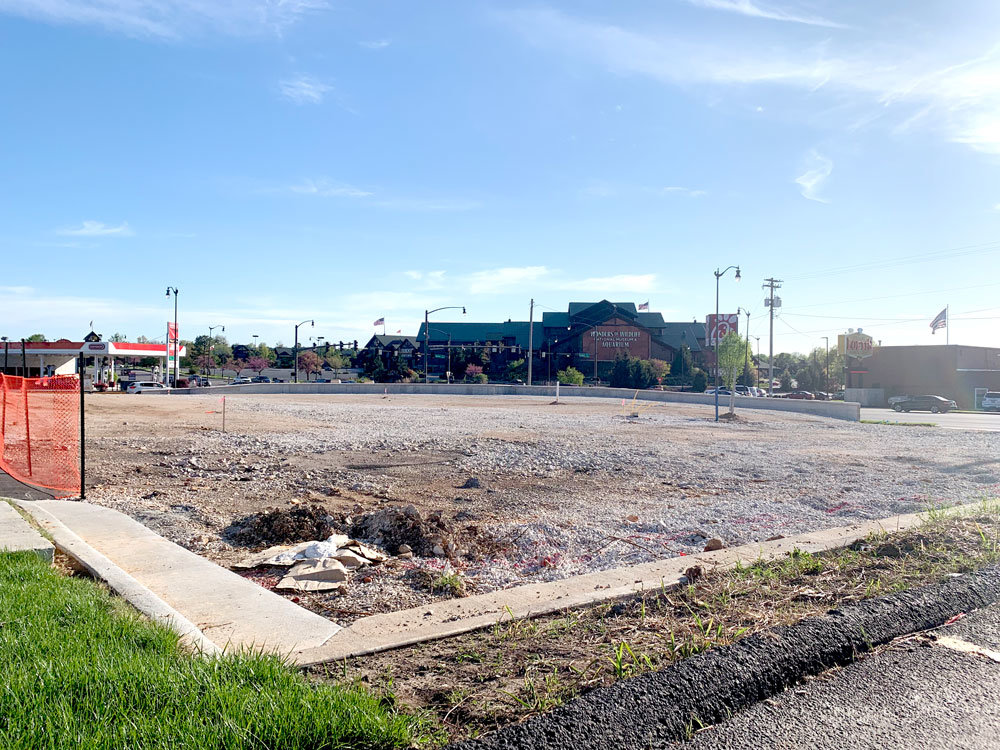 The lot where Raising Cane's is expected to open this summer sits empty April 21.