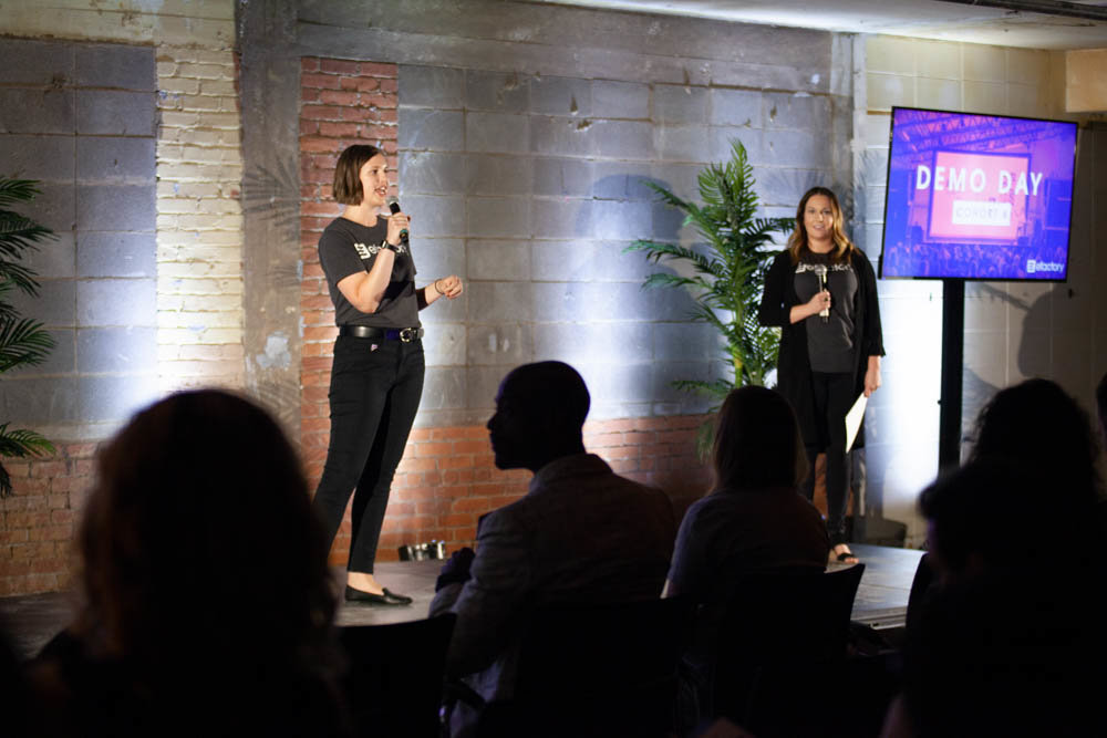 The Efactory's Paige Oxendine, left, and Rachel Anderson speak during the 2019 business accelerator's Demo Day event last August.