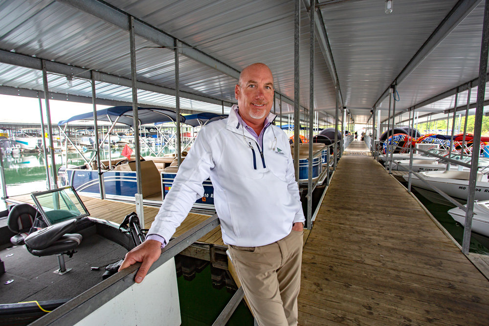 'NAUTICAL DISTANCING': Bob Cox, co-owner of State Park Marina in Branson, says most boating activities meet social distancing requirement.