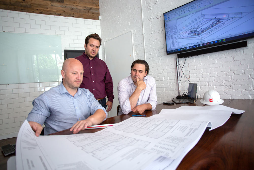Joel Thomas, right, is principal architect at the new local office for Buf Studio, an Arkansas-based firm started in January by Ryan Faust, left, and Christophe Bouteille.