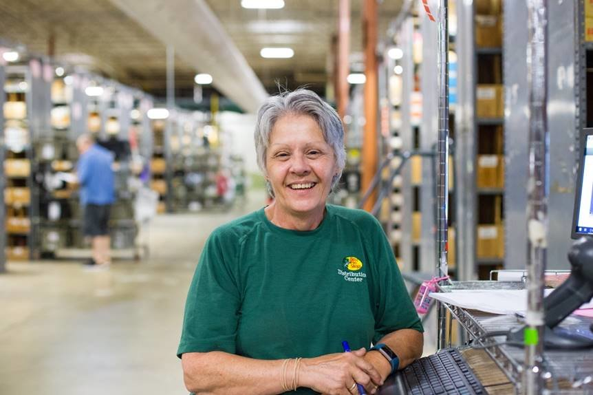 Bass Pro Shops distribution center workers are slated to receive bonuses later this year. Julie Atchison, above, is among the Springfield distribution center's employees.