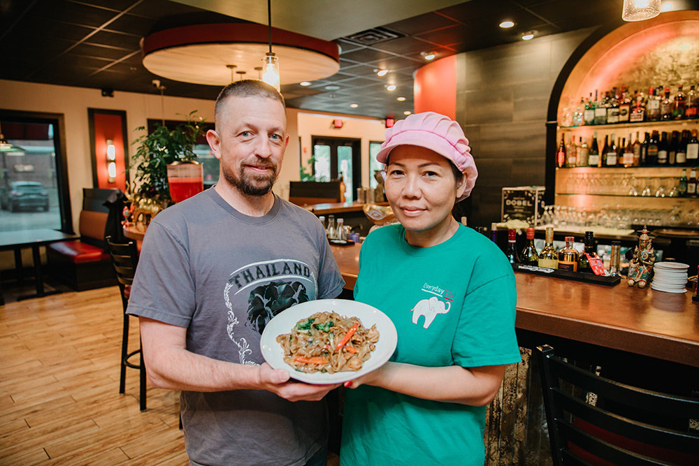 Steven and Thippawan Shutts display their Pad Kee-Mow dish, aka drunken noodles, which he describes as having a wide flavor profile.