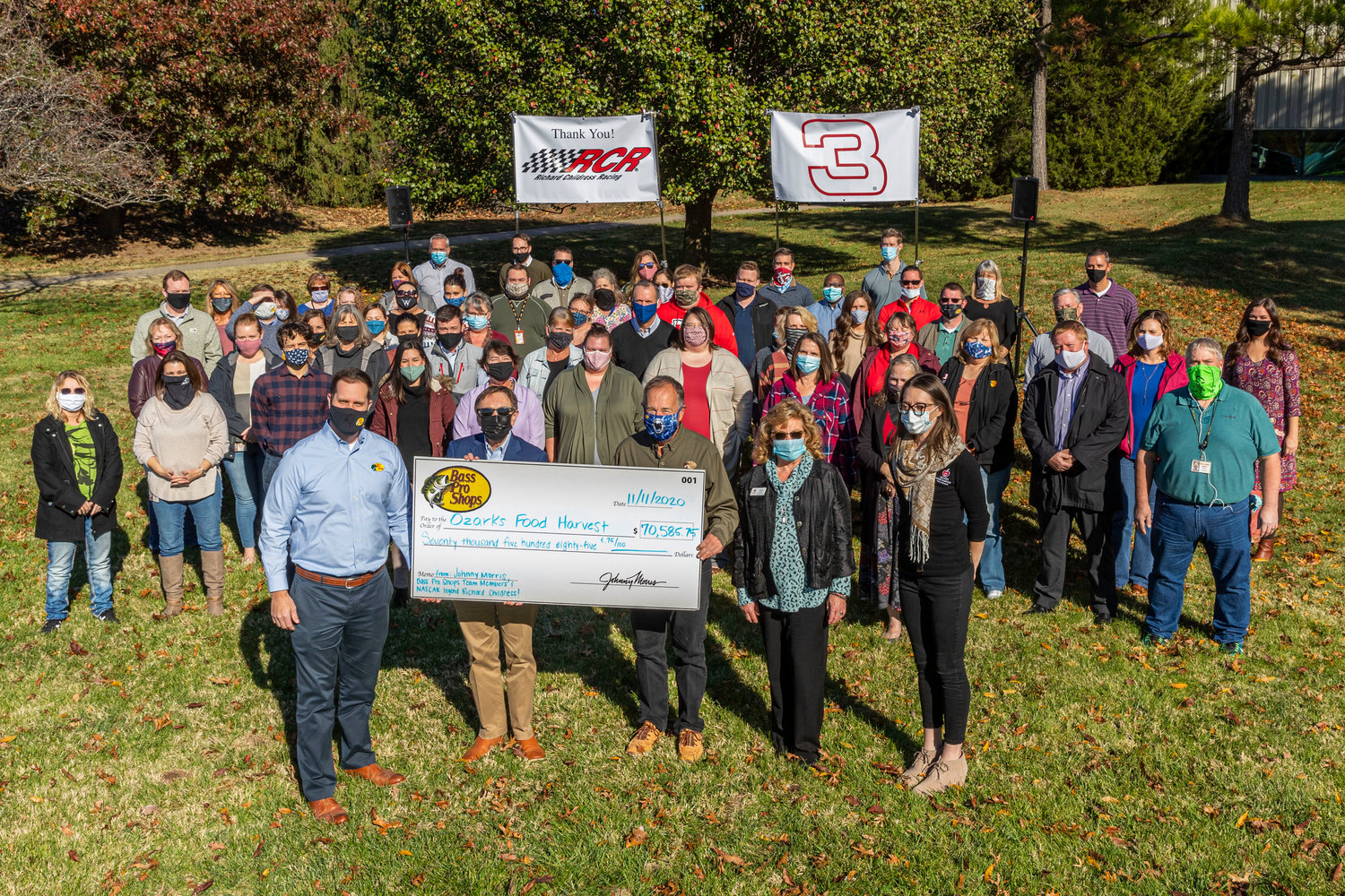Ozarks Food Harvest representatives receive a $70,500 check from Bass Pro Shops founder and CEO Johnny Morris and Bass Pro team members.