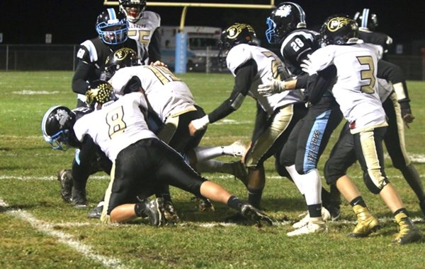 Fallsburg's aggressive defense puts a stop to a Sullivan West running play last year.