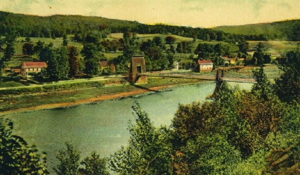 A view from Pennsylvania of a section of the Barryville Suspension Bridge after the center pier was added in 1866.