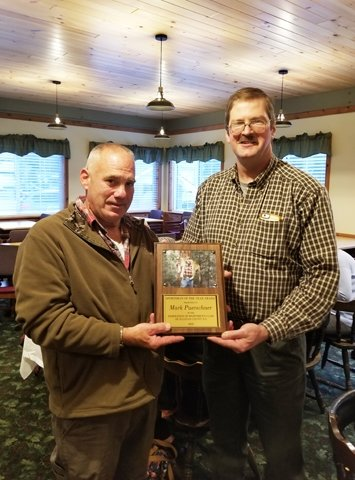 """Vice President of the Sportsmen's Federation John VanEtten (right) presents the """"Sportsman of the Year"""" plaque to Mark Puerschner."""