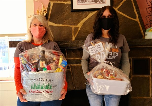 Dolores Bassey of Bethel and Jackie Fahnestock of Greentown, Pennsylvania display two of the thirty themed gift baskets available at the Lois Fahnestock Benefit Raffle Basket and 50/50 Drive-Thru event to be held on Saturday, November 28th at Pecks Market in Eldred. Tickets can be purchased on  the day of the Drive-Thru and  next Saturday November 21st at The Corner Ice Cream Shop in Eldred starting at 11 a.m.