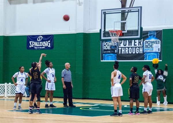 Traynise Delaney makes one of her two foul shots with 30 seconds left to tie the game at 74.