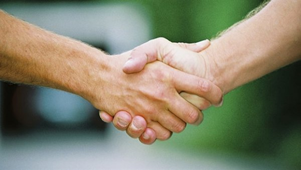 The traditional handshake may become a thing of the past but it might be difficult for us to do.