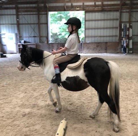 Adeline has enjoyed riding her pony Lollipop.