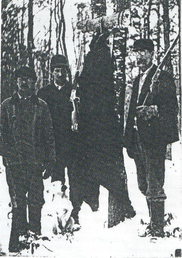 The author Stephen Crane was an avid hunter and often wrote about it. He is believed to be in the center of this bear hunting photo from Forestburgh.