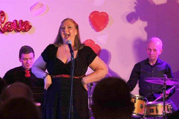 Heather Strauss singing at the Valentine Cabaret.