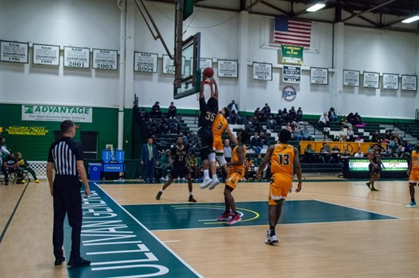 Jordan Drain clears the Essex defender for a dunk in the first half. The SUNY Sullivan men would go on to defeat Essex 107-61.