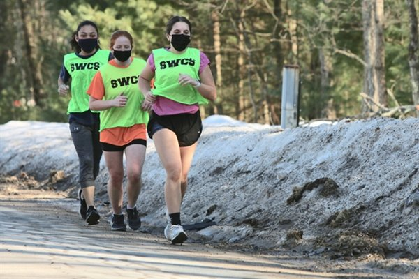Sullivan West lady harriers stride along towards the finish of their workout set up by Coach Skylar Musa and volunteer assistant Dee Maopolski. They are  (in order) Brielle Arnot, Cheyenne Decker and Rose-Lynn Murphy.