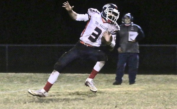 Tri-Valley junior Brian Kelly eluded tacklers but eventually lost his balance. Kelly was the Bears' leading rusher and caught quarterback Austin Hartman's only pass completion for an 18-yard gain.