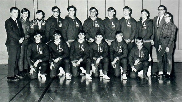 The 1967-68 Liberty High School wrestling team. Ron Lewis is kneeling far right. Ted Lewis is standing fourth from the right.