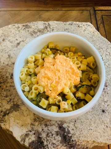 With corn and zucchini being in season, I figured why not make a beautiful corn and zucchini pasta with spicy ricotta?
