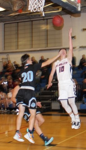 Tri-Valley's Austin Delaney (10) goes up for a two-point attempt as Sullivan West's Nick Dworetsky (20) attempts a block.