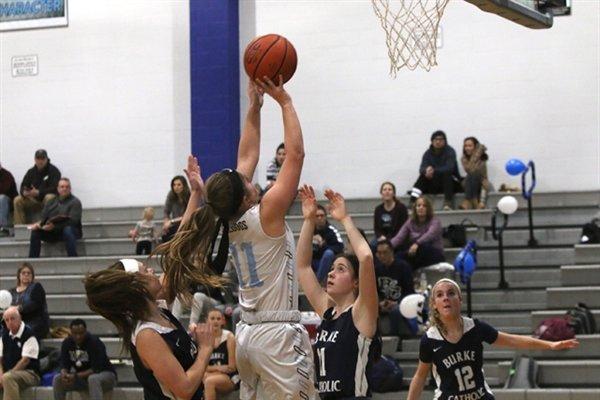 Sullivan West senior Keri Burr nets two of her eight points on the night.