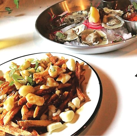 My first time visiting I savored over poutine and oysters with a mignionette sauce.