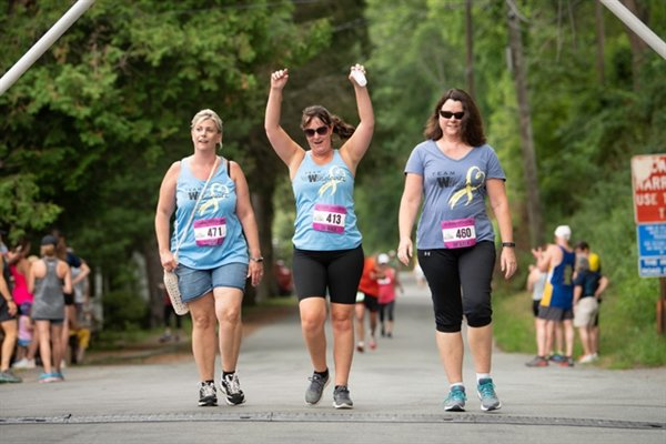 From left, Team Winglovitz members Cheryl Stauch, Kathleen Digiovanni and Debbie Reimer cross the finish line at the 2019 River Run.