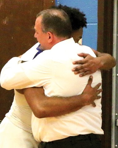 Coach Russo has one of many hugs as his players come off the floor following their semifinal win over FDR. The feeling and respect the players have for him and his devotion to them are part and parcel of the team's successful dynamic.