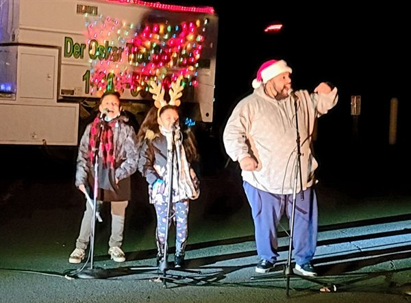 Senior Pastor Charles Perez of the Barryville United Methodist Church along with his son Jo-Jo (left) aged 10 yrs and daughter Serenity 8 yrs old led the crowd in a rousing sing along of Feliz Navidad during the Greater Barryville Chamber of Commerce Annual Tree Lighting.