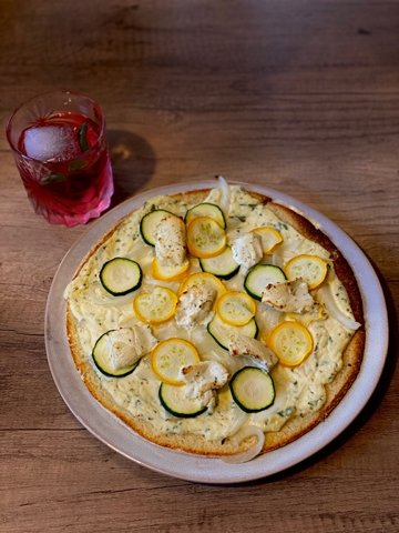 I made a beautiful zucchini pizza to use up some fresh produce, but this would be amazing on flatbread or a piece of naan.