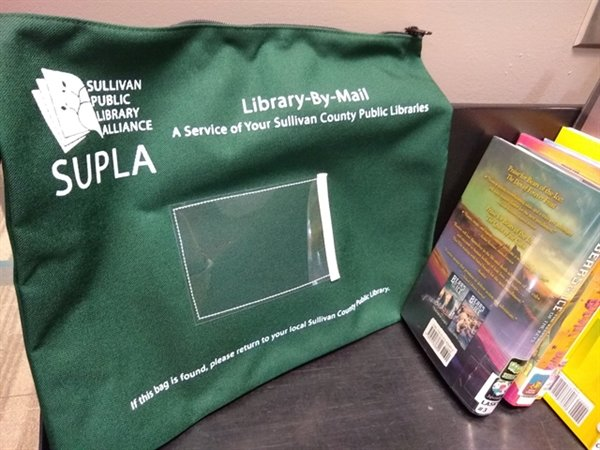 Once the application for Library-by-Mail Service is processed participants will start receiving books (regular print or large print), audiobooks and/or magazines through the mail in a special green canvas Library-by-Mail delivery bag.