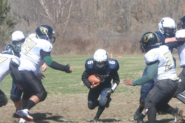 Roscoe junior Alaniz Ruiz runs up the middle for the first of his two touchdowns on the day.