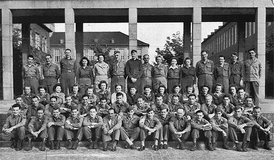 The 96th Evacuation Hospital male and female personnel pose in Halle, Germany. Pfc. John Conway is seventh from the right in the front row.