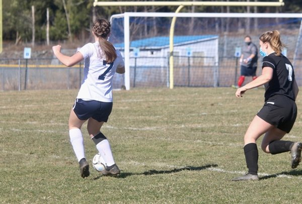Seven on seven. Tri-Valley's  #7 Madison Botsford advances the ball while Sullivan West's #7 shadows her closely. Smith had an assist on a goal by teammate Anna Bernas.