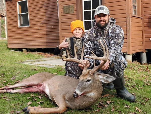 Forest Darder with the monster whitetail he got on the opening day of Bow Season in the Town of Neversink. It measured 72.5 to win the Democrat's Big Buck Bow Contest. Helping him show off his buck is his son and future big buck hunter Jack Darder.