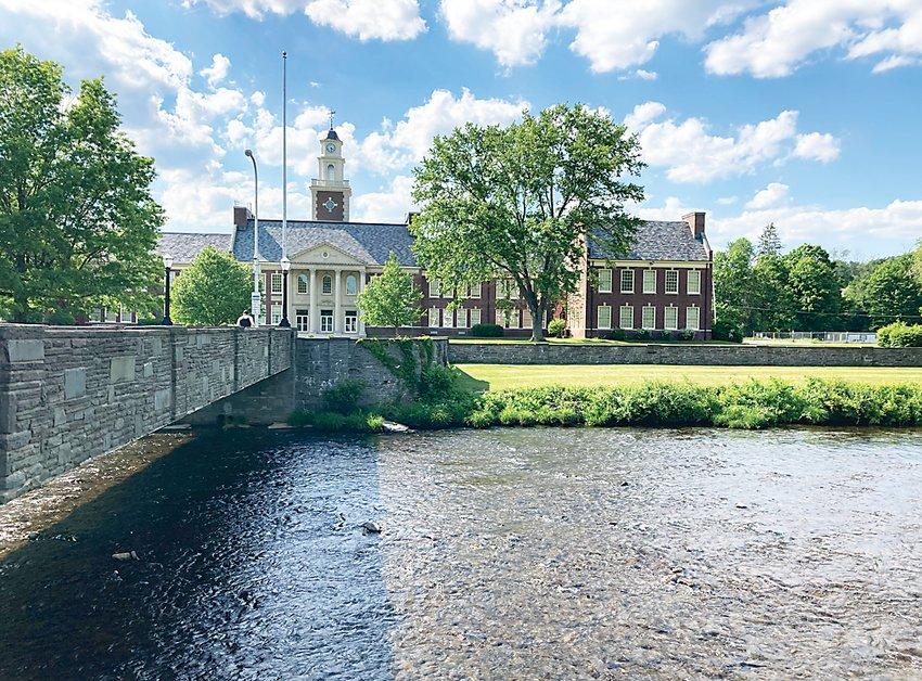 "The Willowemoc flows under the ""walk across bridge""by Livingston Manor School."