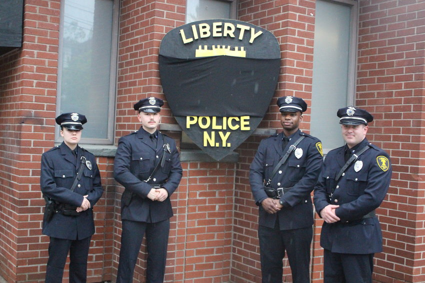 The newest inductees to the Village of Liberty Police Department include (from left to right) Officer Breann Jones, Officer Andres Arestin, Officer Larrie Williams and Officer Christopher Orlando.