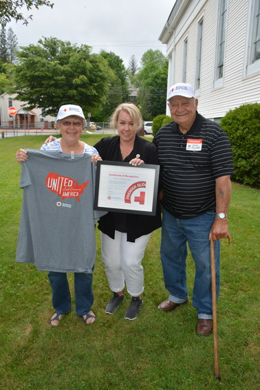 Lynn Pettit (center), American Red Cross Account Manager for Sullivan, Broome and Delaware Counties, presents Marjory and Jack Foster with a certificate of recognition at last Thursday's Blood Drive.