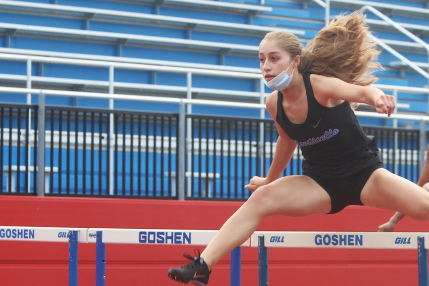 Monticello sophomore Taina DeJesus strides to victory in the Section 9 Class B 100 hurdles with a season best time of 15.80. Later she went on to capture gold in the 400 hurdles with another PR of 1:06.60. She made it three for three by running a leg in the Monti's 4x100 relay.