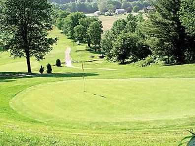 This photo of the 4th hole at the Twin Village golf course shows the original tee, green and fairway.
