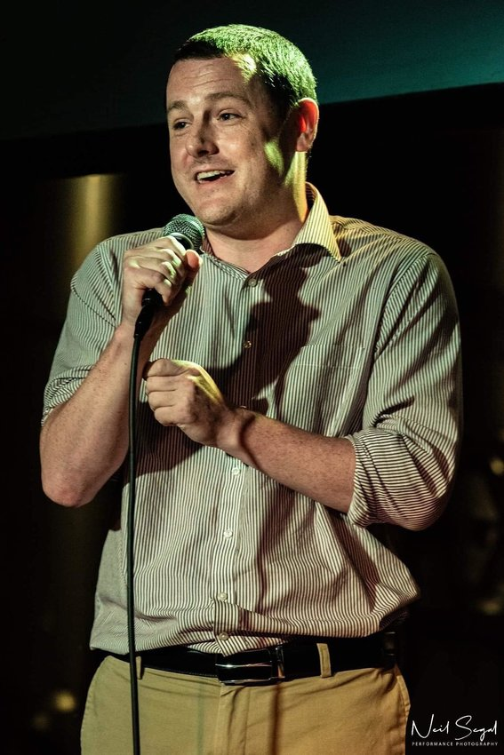 Michael performing stand-up comedy.