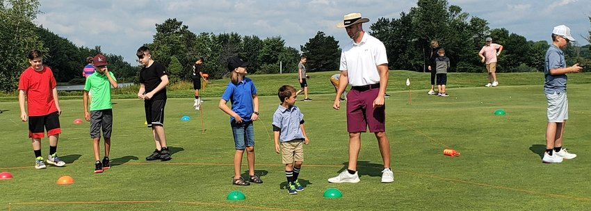 Instructor Joe Franke gives Swan Lake Golf & Country Club campers golf instructions.