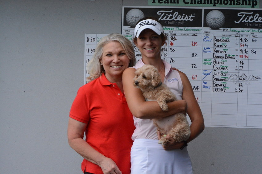The champs! Jill and Melanie Kleiner won the inaugural Catskill Women's Team Championship at the Villa Roma on Sunday. Melanie is holding beloved family pet, Pro Shop Buddy.
