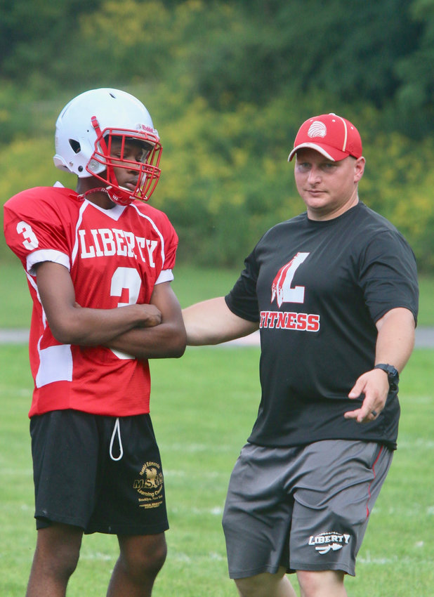 Liberty head football coach counsels junior running back/cornerback Giovanni Dudley on a kickoff drill. A clap of thunder mandated a quick exit from the field but when the skies cleared the Indians were right back at it. Look for a resurgence of Liberty Indians football under the tutelage of newly appointed head football coach Adam Lake.
