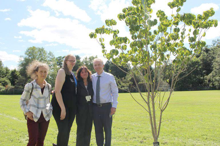 Family friend Irinel Stegaru-MacLaughlin, Chris' fiance Barbara Schulze, mother Jane Sorensen and father Alan Sorensen pose with the dogwood tree planted in Chris' honor.