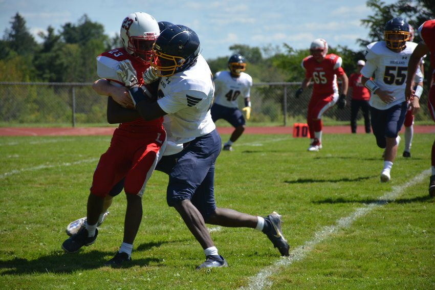Liberty's Giovanni Dudley (left) fights for a few extra yards.