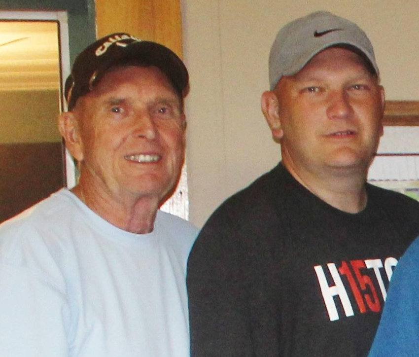 The father and son duo of Chuck Husson III, left, and Chuck Husson IV are the champions for the fourth year in a row of the Monday Night Men's league at the Roscoe Twin Village Golf Course.