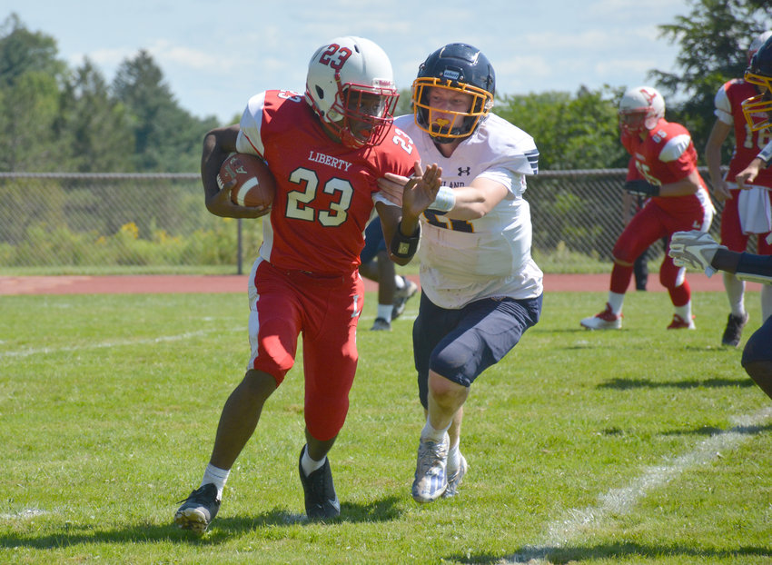 Liberty's Giovanni Dudley evades a Highland defender. The Indians fell to the Huskies, 32-6, in their season opener last Saturday. Liberty Coach Adam Lake said despite the loss, several positives came from the game. To read the full story about the game, visit scdemocratonline.com.