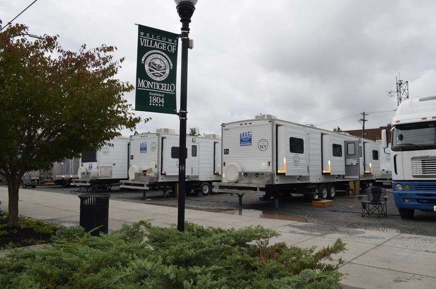 Trailers, tractor trailers and storage units of all sizes filled the entire parking lot at the corner of Broadway and St. John Street in the Village of Monticello yesterday. The set was just a short walk across Broadway, up Bank Street to the former Sullivan County Jail.