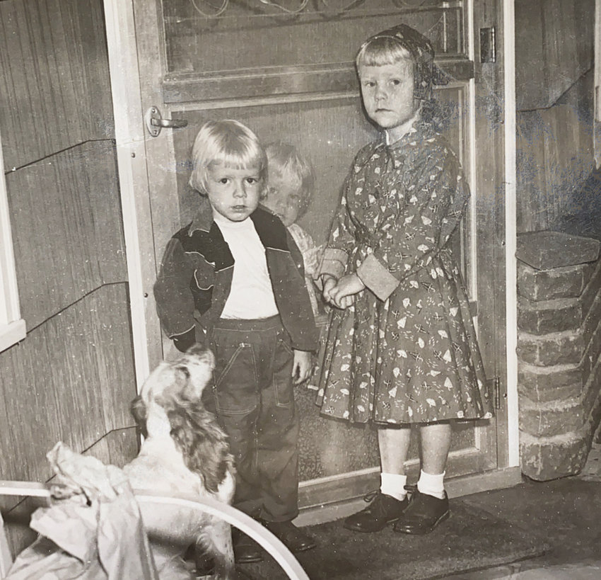 September 3, 1957- Kathy (right) on the first day of kindergarten. Sister Billie (center) is behind the screen door. Sister Laurie (left) is none too happy at not being able to go to school yet. Our faithful dog Sugar stands at the ready.