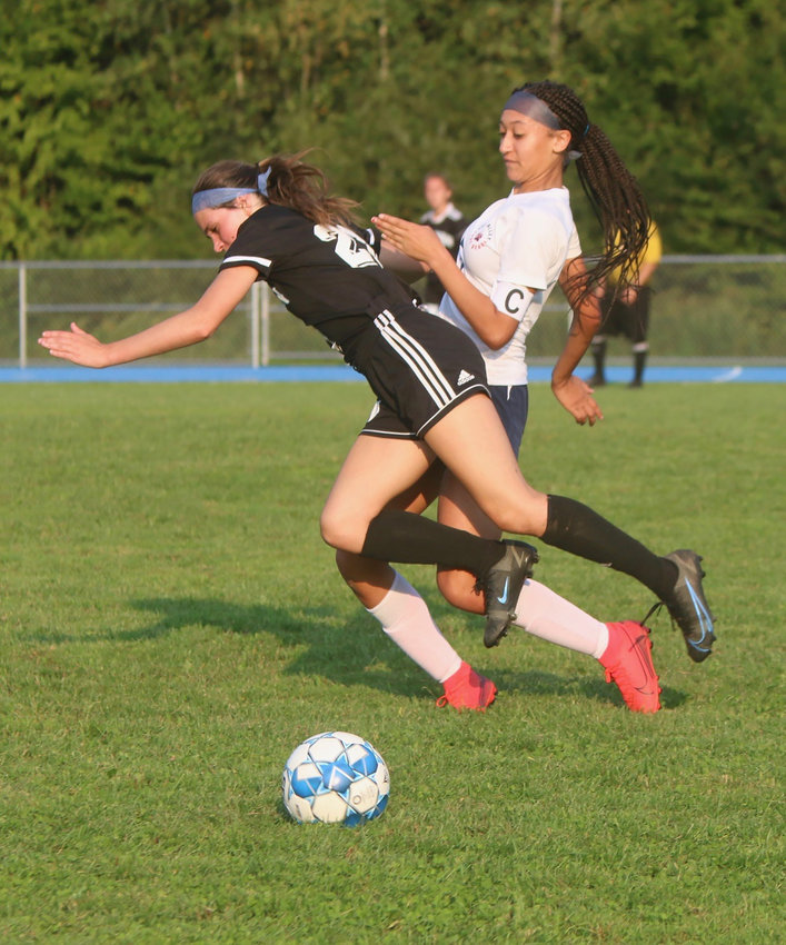 Sullivan West's Grace Boyd and Tri-Valley's Kendall McGregor vie for a ball in midfield. Both are extremely agile and skillful players. Boyd scored two of her team's six goals, while McGregor scored the lone goal for the Lady Bears.