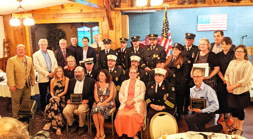 The 2021 Upper Delaware Council Honorees are as follows: Seated first row (left to right) are Richelle Dufton, Steve Schwartz, Sherri Resti Thomas, Bonnie Sheard, Sparrowbush Engine Co. (SECO) 2nd Assistant Chief Danielle Glynn, Mike Coppola. Seated 2nd row (left to right) are Rocky Pinciotti, Deputy Chief Jack Flynn, 2nd Assistant Chief Carl L. Van Horn, Chief Jeremy Swingle, Firefighter Kayla Degraw (SECO). Standing (left to right) are Highland Town Supervisor Jeff Haas, Andy Boyar, John Conway (The Delaware Company), Tim Bruno (WJFF Radio Catskill), Steve Melendez (The Delaware Company), Larry H. Richardson, Firefighter Scott Glynn, 2nd Lt. Kevin Fisher, Fire Police Captain Marty Reiser, Captain Michael Reiser, Firefighter Heather Van Horn, Dive Master Chris Morgan (SECO); Delaware Town Clerk Tess McBeath, Sullivan County Legislature Chairperson Robert Doherty, Sullivan County Planning Commissioner Freda Eisenberg, and Sullivan County Senior Planner Heather Jacksy.